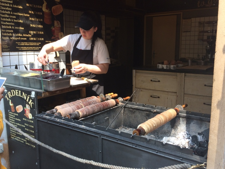 A street vendor making a trdelnik pastry in Prague